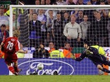 Liverpool's Dutch forward Dirk Kuyt scores the winning penalty past Chelsea's Czech goalkeeper Petr Cech to win the European Champions League semi final second leg football match at Anfield, Liverpool, north west England, 01 May 2007