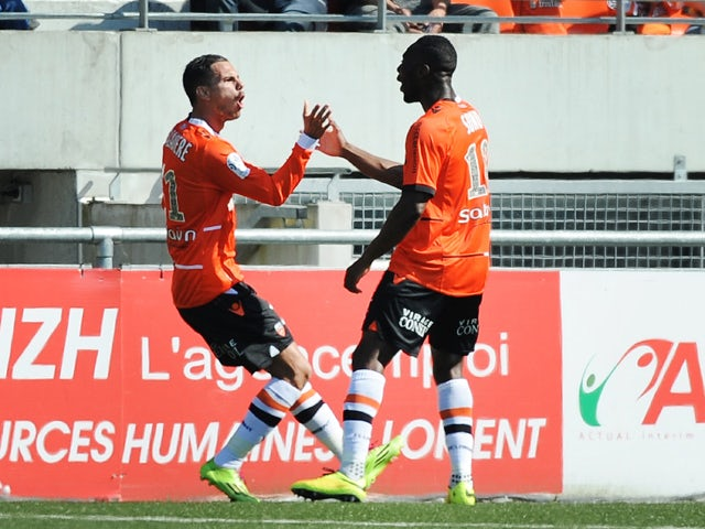 Lorient French forward Jeremie Aliadiere celebrates after scoring a goal with Lorient's forward Gilles Sunu who provided the assist, during the French L1 football match between Lorient and Ajaccio on May 4, 2014