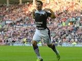 Luis Suarez celebrates scoring for Liverpool against Sunderland on September 29, 2013.