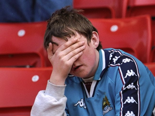 A Manchester City fan reacts to his team being relegated to Division Two on May 03, 1998.
