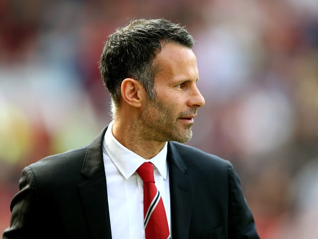 Ryan Giggs the Manchester United interim manager looks on during the Barclays Premier League match between Manchester United and Sunderland at Old Trafford on May 3, 2014