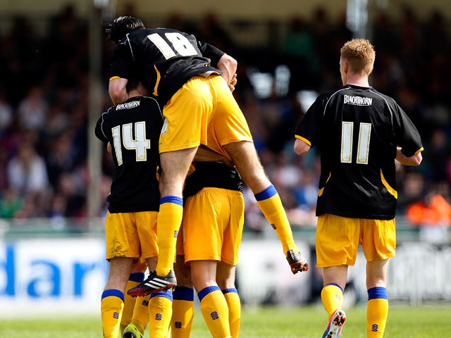 Colin Daniel of Mansfield is mobbed by team mates after scoring the opening goal of the game during the Sky Bet League Two match between Bristol Rovers and Mansfield Town at Memorial Stadium on May 3, 2014
