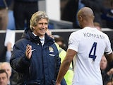Manchester City manager Manuel Pellegrini congratulates Vincent Kompany at the end of the Premier League match against Everton on May 3, 2014