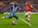 Marc-Antoine Fortune of Wigan Athletic crosses the ball under pressure from Kieran Gibbs of Arsenal during the FA Cup Semi-Final match between Wigan Athletic and Arsenal at Wembley Stadium on April 12, 2014