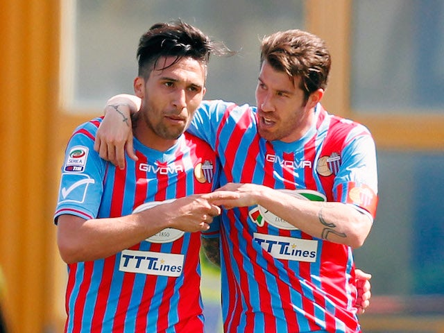 Mariano Izco of Catania celebrates with his team-mate Lucas Castro after scoriing their second goal during the Serie A match against AS Roma on May 4, 2014