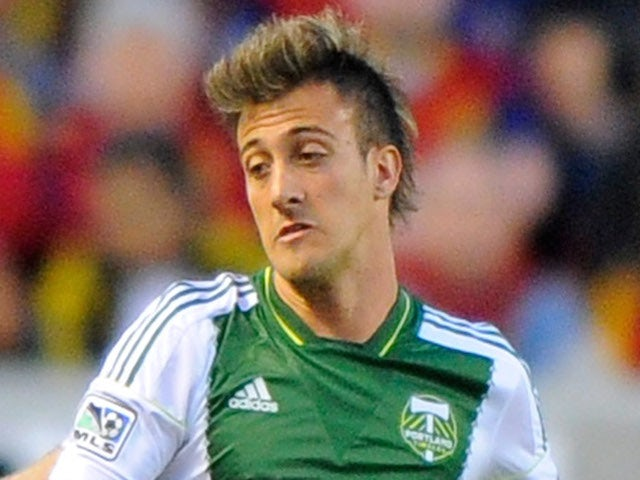 Maximiliano Urruti #37 of the Portland Timbers try for the ball during their game at Rio Tinto Stadium April 19, 2014