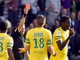 Nantes' Senegalese defender Papy Mison Djilibodji is sent off by the referee after an altercation during the French L1 football match Toulouse against Nantes on May 04, 2014