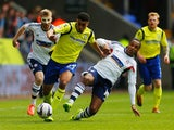 Neil Danns of Bolton Wanderers tackles Tom Adeyemi of Birmingham City during the Sky Bet Championship match on May 3, 2014