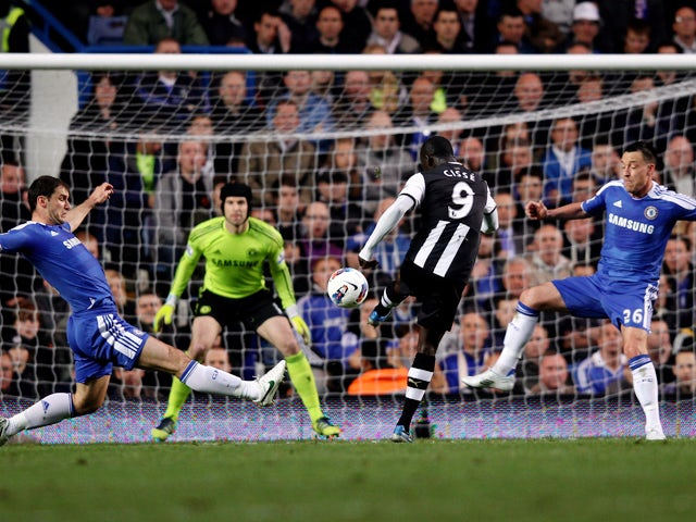 Papiss Cisse of Newcastle scores the opening goal despite the efforts from Branislav Ivanovic (L) and John Terry of Chelsea during the Barclays Premier League match between Chelsea and Newcastle United at Stamford Bridge on May 2, 2012