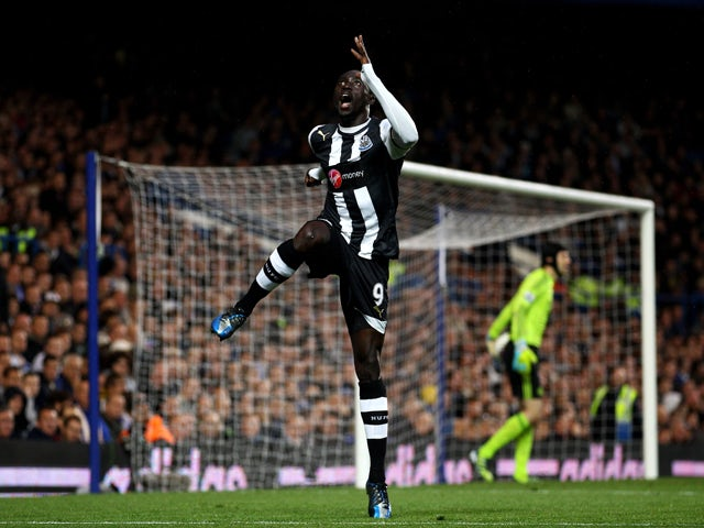 Papiss Cisse of Newcastle celebrates after scoring the opening goal during the Barclays Premier League match between Chelsea and Newcastle United at Stamford Bridge on May 2, 2012