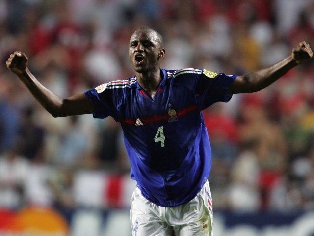 Former Arsenal midfielder Patrick Vieira celebrates scoring for France on June 13, 2004.