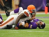 Christian Ponder #7 of the Minnesota Vikings reacts to a tackle by Phillip Taylor #98 of the Cleveland Browns on September 22, 2013