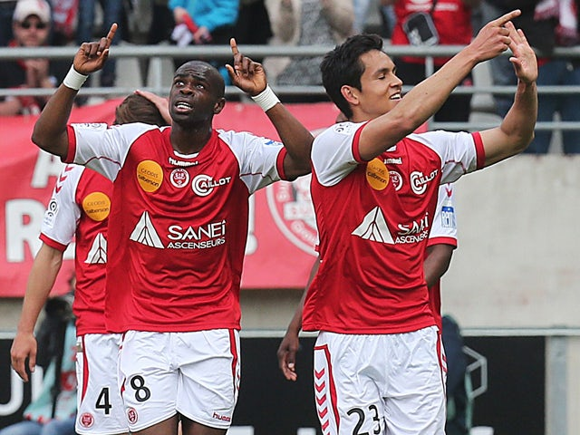 Reims' Congolese midfielder Prince Oniangue celebrates after scoring a goal during the French L1 football match between Reims (SR) and Evian (ETGFC) on May 4, 2014