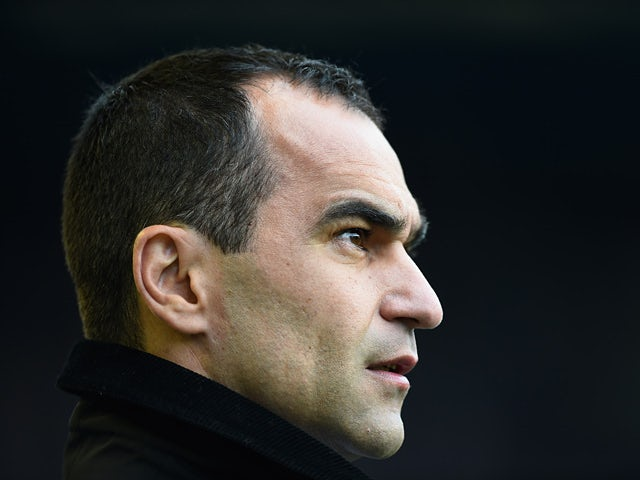 Everton manager Roberto Martinez looks on prior his his team's match against Manchester City in the Premier League match on May 3, 2014