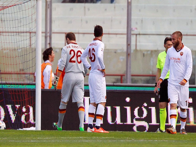 Players of Roma show their dejection during the Serie A match between Calcio Catania and AS Roma at Stadio Angelo Massimino on May 4, 2014
