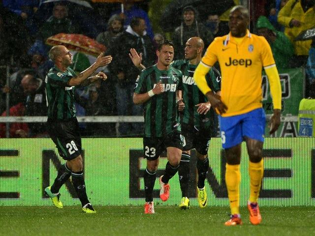 Sassuolo's forward Simone Zaza celebrates after scoring a goal during the Italian seria A football match Sassuolo vs Juventus, on April 28, 2014