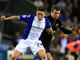 Scott Allan of Birmingham City and James McArthur of Wigan Athletic challenge for the ball during the Sky Bet Championship match on April 29, 2014