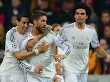 Real Madrid's defender Sergio Ramos (C) celebrates scoring the second goal against Bayern Munich with his teammates on April 29, 2014