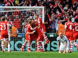 Rickie Lambert of Southampton is congratulated by team mates as he scores during the Barclays Premier League match between Swansea City and Southampton at Liberty Stadium on May 3, 2014