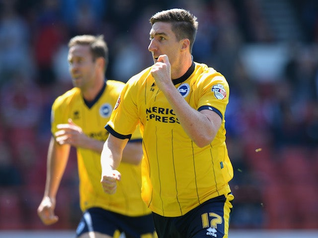 Stephen Ward of Brighton & Hove Albion celebrates scoring their first goal during the Sky Bet Championship match against Nottingham Forest on May 3, 2014