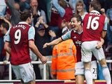 West Ham United's English midfielder Stewart Downing (2nd R) celebrates scoring his team's second goal during the English Premier League football match against Spurs on May 3, 2014