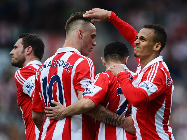 Peter Odemwingie (R) of Stoke City celebrates with team mates after scoring during the Barclays Premier League match between Stoke City and Fulham at the Britannia Stadium on May 3, 2014