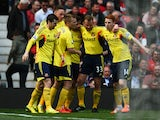 Sebastian Larsson of Sunderland is congratulated by teammates after scoring the opening goal during the Barclays Premier League match between Manchester United and Sunderland at Old Trafford on May 3, 2014