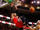 Taj Gibson #22 of the Chicago Bulls dunks the ball against the Boston Celtics in the second half during the game at TD Garden on March 30, 2014