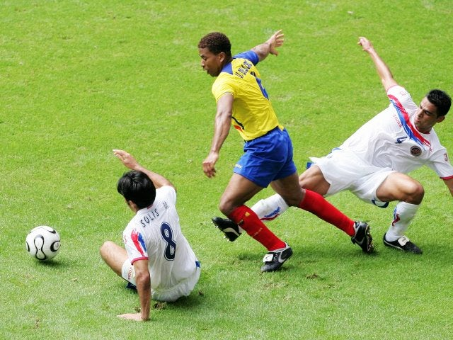 Ecuador defender Ulises de la Cruz battles for possession against South Korea on June 15, 2006.