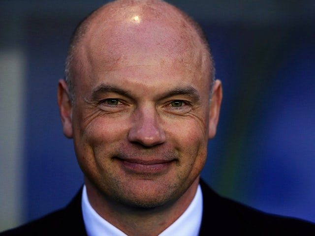 Wigan manager Uwe Rosler smiles during the Champioship match against Birmingham on April 29, 2014