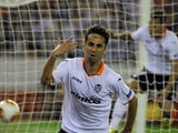 Caption:Valencia's Brazilian forward Jonas celebrates after scoring during the UEFA Europa League semi-final second leg football match Valencia CF vs FC Sevilla at the Mestalla stadium in Valencia on May 1, 2014