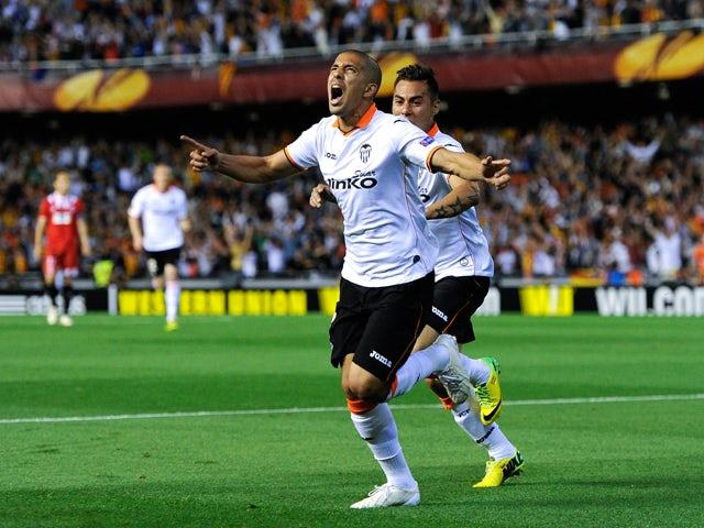 Sofiane Feghouli of Valencia CF celebrates after scoring the opening goal during the UEFA Europa League Semi Final second leg match between Valencia CF and Sevilla FC at Estadi de Mestalla on May 1, 2014