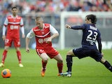 Valenciennes' Rudy Mater challenges Bordeaux's Argentinian midfielder Lucas Orban during the French L1 football match between Valenciennes and Bordeaux at the Stade du Hainaut in Valenciennes on May 4, 2014