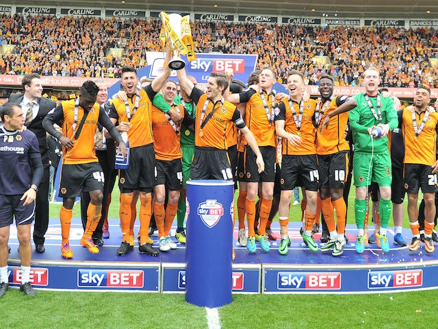 Wolves players celebrate after with the League One trophy on May 3, 2014