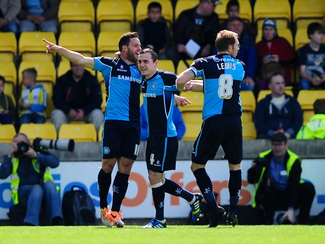 Sam Wood of Wycombe Wanderers celebrates scoring his side's first goal during the Sky Bet League Two match between Torquay United and Wycombe Wanderers at Plainmoor on May 3, 2014