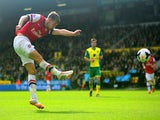 Aaron Ramsey of Arsenal scores the opening goal during the Barclays Premier League match between Norwich City and Arsenal at Carrow Road on May 11, 2014