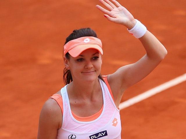 Agnieszka Radwanska celebrates victory over Caroline Garcia in their quarter final Madrid Masters match on May 9, 2014