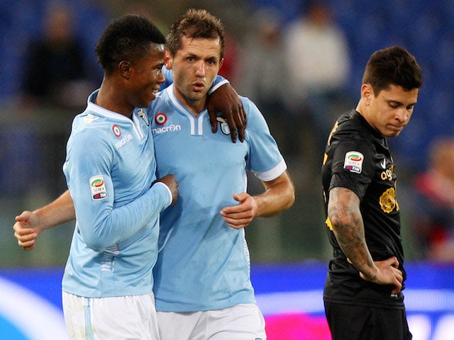 Senad Lulic (C) with his teammate Balde Diao Keita of SS Lazio celebrates after scoring the second team's goal against Hellas Verona on May 5, 2014