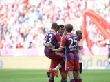 Bayern Munich's player celebrate scoring after the German first division Bundesliga football match FC Bayern Munich vs VFB Stuttgart in Munich, southern Germany, on May 10, 2014
