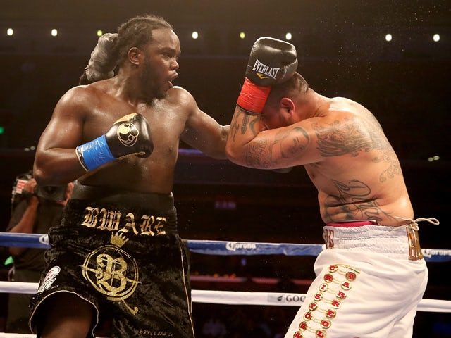 Bermane Stiverne throws a punch at Chris Arreola in their WBC Heavyweight Championship match at Galen Center on May 10, 2014