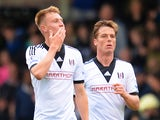 Cauley Woodrow (L) of Fulham celebrates his goal during the Barclays Premier League match between Fulham and Crystal Palace at Craven Cottage on May 11, 2014
