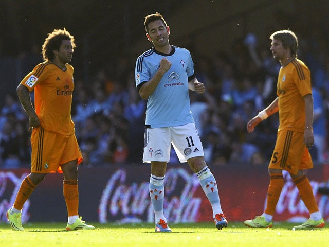 Celta's Charles celebrates after scoring his team's second goal against Real Madrid during the La Liga match on May 11, 2014