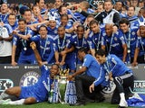 Chelsea players celebrate with the Barclays Premier League trophy after they win the title with a 8-0 victory over Wigan Athletic in the English Premier League football match on May 9, 2010