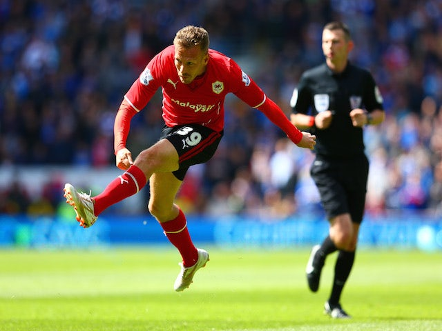 Craig Bellamy of Cardiff City scores the opening goal during the Barclays Premier League match between Cardiff City and Chelsea at Cardiff City Stadium on May 11, 2014