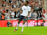 England striker Danny Welbeck celebrates scoring against Scotland on August 14, 2013.