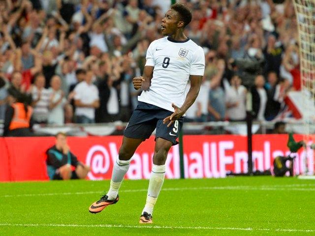 England striker Danny Welbeck celebrates scoring against Scotland on August 14, 2013.