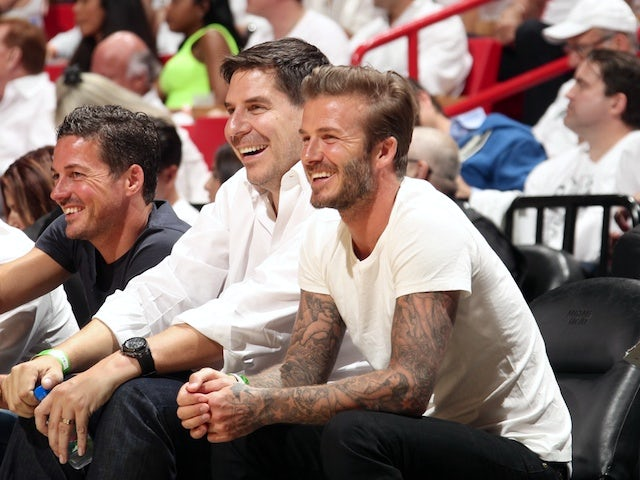 David Beckham looks on from courtside during the Eastern Conference semi-final NBA playoff game between the Miami Heat and Brooklyn Nets on May 6, 2014