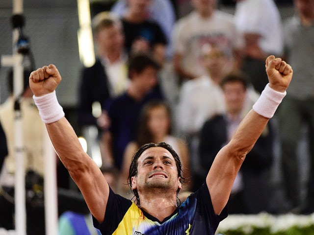 David Ferrer celebrates victory over Ernests Gulbis in their quarter final Madrid Masters match on May 9, 2014