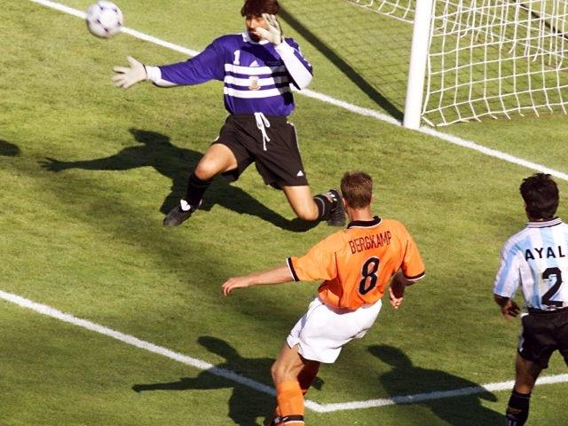 Dennis Bergkamp scores for Holland against Argentina on July 04, 1998.