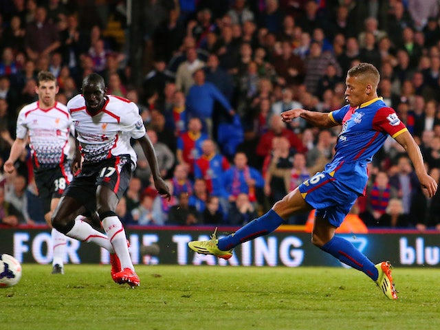 Dwight Gayle of Crystal Palace scores his team's third goal to level the scores at 3-3 during the Barclays Premier League match against Liverpool on May 5, 2014